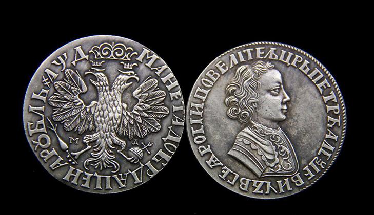 Петровский серебряный рубль 1704 года