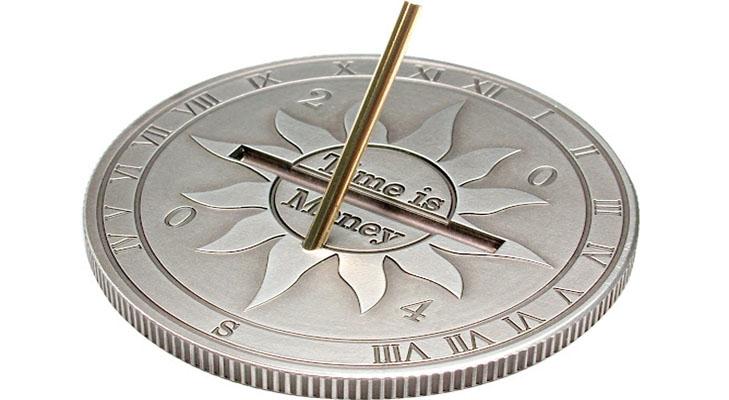 Монета в виде солнечных часов